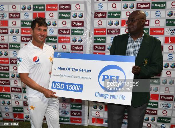 Man of the Series Yasir Shah receives his award from Dominica official Vincent Elwin after Pakistan won the final test match and the series 21...