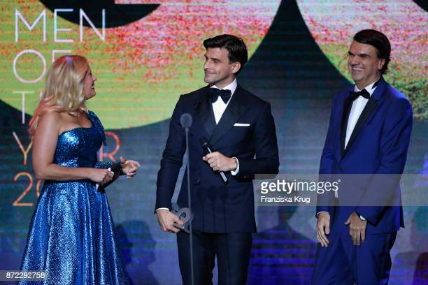 Man of the year Johannes Huebl Barbara Schoenberger and GQ publisher Andre Pollmann are seen on stage at the GQ Men of the year Award 2017 show at...