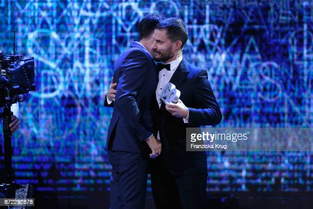 GQ Man of the year Simon Verhoeven and Clemens Schick are seen on stage at the GQ Men of the year Award 2017 show at Komische Oper on November 9 2017...