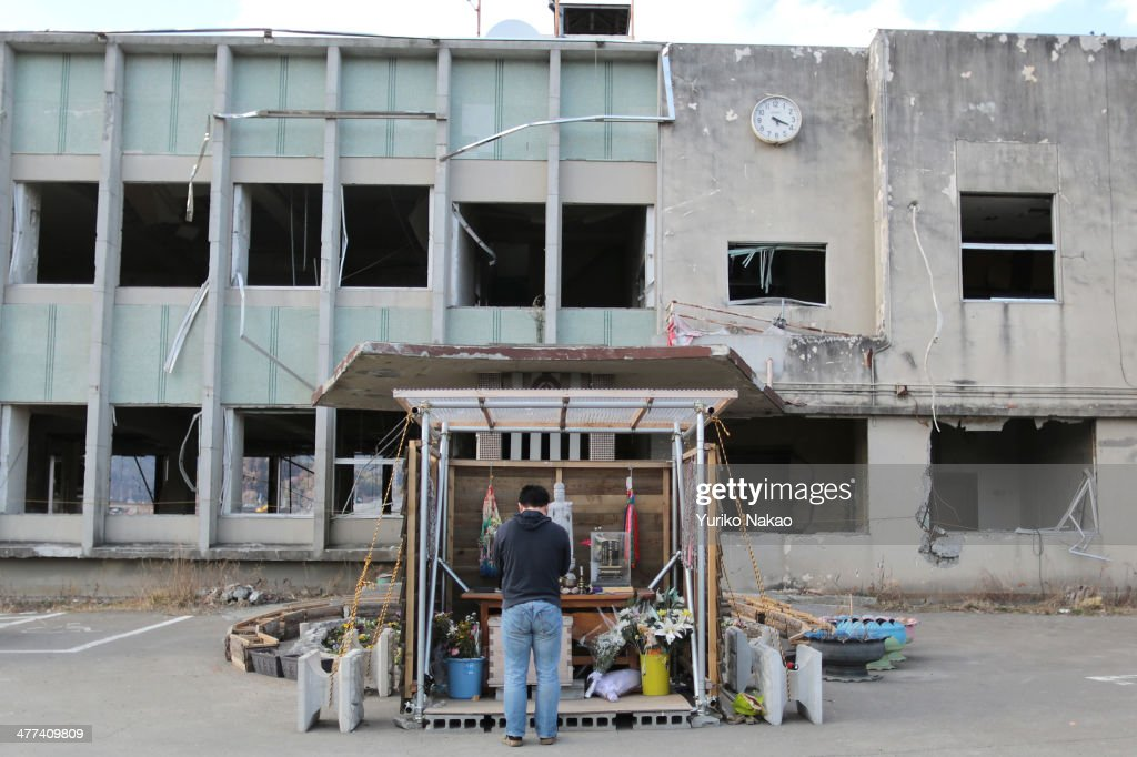 A man offers a prayer in front of former Otsuchi City Hall damaged by the tsunami three years ago on March 9, 2014 in Otsuchi, Iwate, Japan. On March 11 Japan commemorates the third anniversary of the magnitude 9.0 earthquake and tsunami that claimed more than 18,000 lives, and subsequent nuclear disaster at the Fukushima Daiichi Nuclear Power Plant.