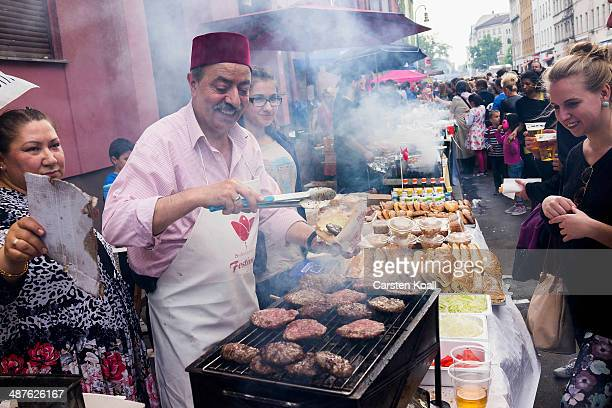 A man offers food on his stand to the people while they gather the MyFest street fest in immigrantheavy Kreuzberg district on May Day on May 1 2014...