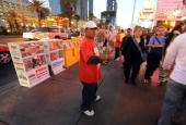 A man offers photo leaflets advertising callgirls in Las Vegas Nevada on April 18 2009 Nevada is one of the only two US states that allow some legal...