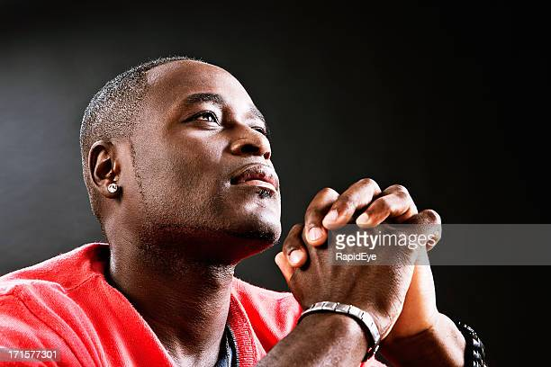 Man offers up heartful prayer, hands clasped