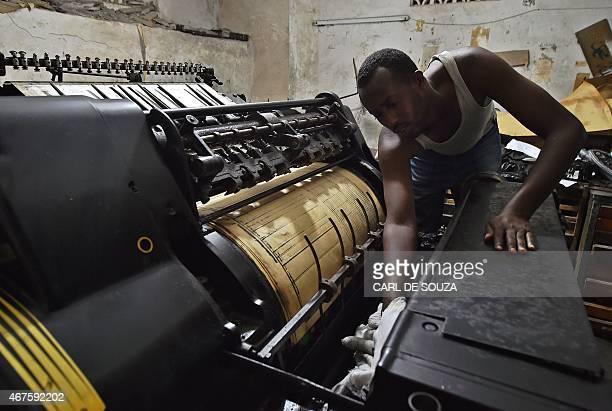 A man oils an old original Heidelberg printing press at the Daha printing press in Mogadishu on March 26 2015 The vintage Germanbuilt machine was...