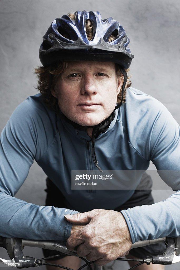 Man on a bike wearing a helmet