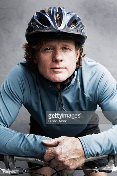Man on a bike wearing a helmet