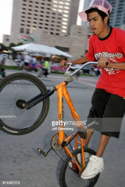 A man on a freestyle BMX at Biscayne Boulevard