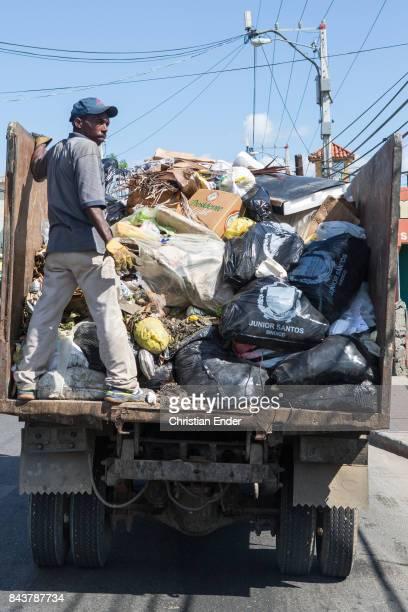 Santa Domingo Dominican Republic November 30 2012 A man on a garbage removal truck in the poor neighbourhood 'Los Alcarrizos' in Santa Domingo