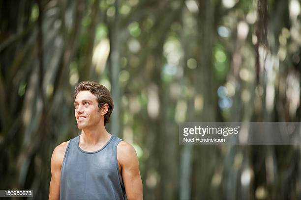 A man on a hike in a banyan tree forest
