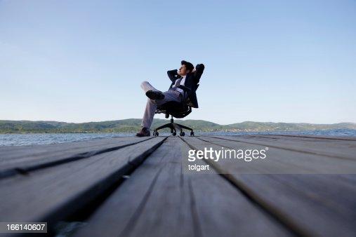Man on a jetty thinking outdoor : Stock Photo