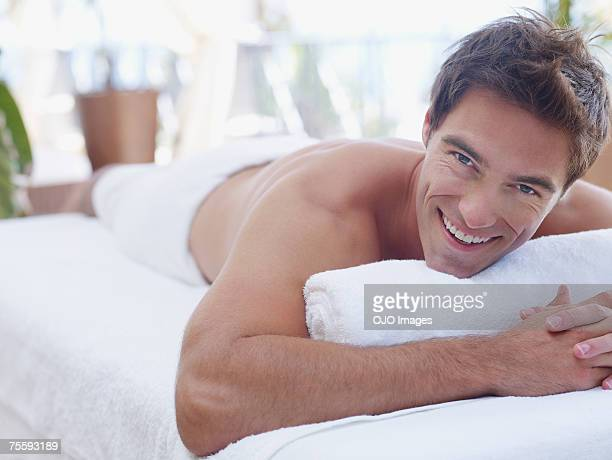 Man on a massage table in a towel