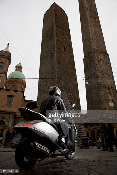 Man on a moped by the two towers, Bologna, Italy