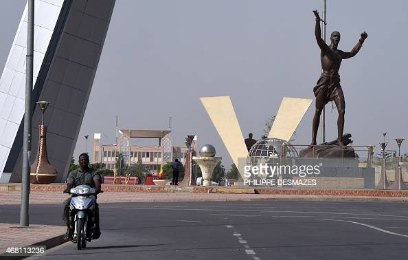 A man on a motorbike rides past Nation square in N'Djamena on March 30 2015 AFP PHOTO / PHILIPPE DESMAZES