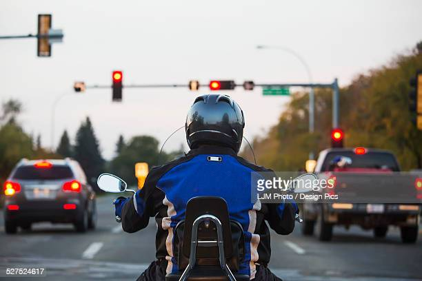 Man on a motorcycle in traffic