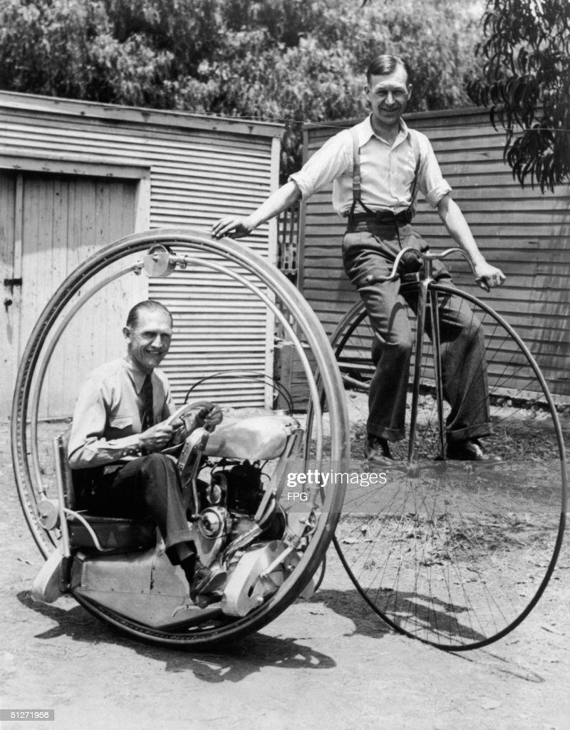 A man on a pennyfarthing bicycle alongside Walter Nilsson aboard the Nilsson monowheel 1935
