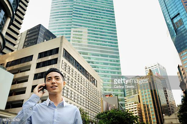 Man on a smart phone in Singapore business area