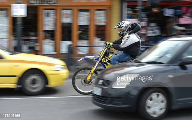 A man on a trail bike crashes into a taxi on Station Street near Frankston railway station after attempting to avoid police wishing to pull him over...