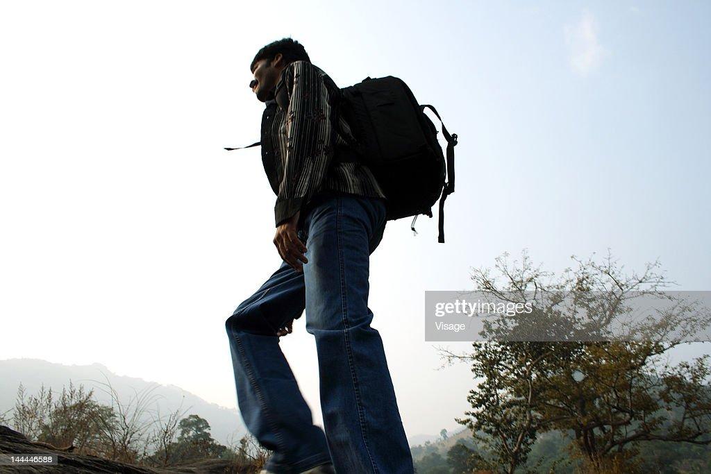 A man on a trekking journey : Stock Photo