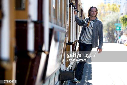 Man on a trolly in San Francisco.