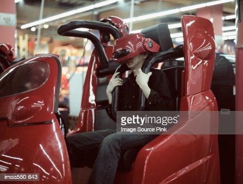 Man on a virtual reality ride : Stock Photo