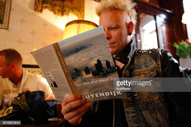 A man on April 30 2015 in Leiden Netherlands is seen the recently released book by Dutch author Joris Luyendijk who spent three years interviewing...