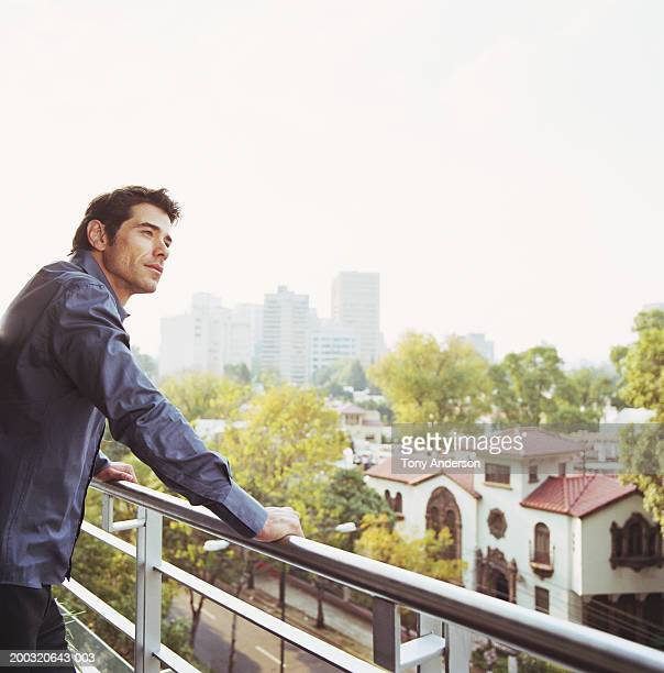 Man on balcony looking at scenery