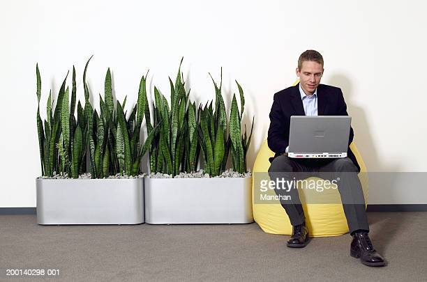 Man on beanbag using laptop