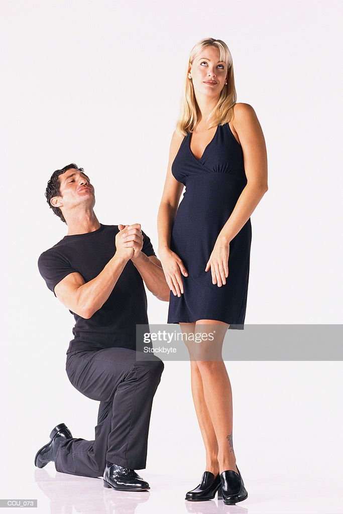 Man on bended knee  woman standing : Stock Photo