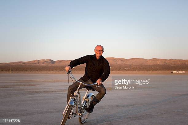 Man on bike in desert