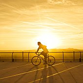 Man on bike in late afternoon sun