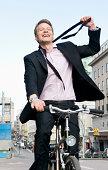 Man on bike loosen tie
