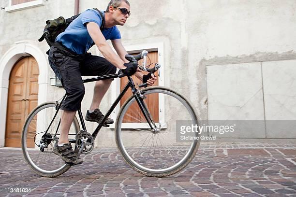 Man on black vintage road bike