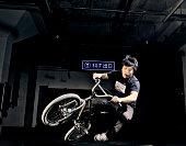 Man on BMX bike performing jump