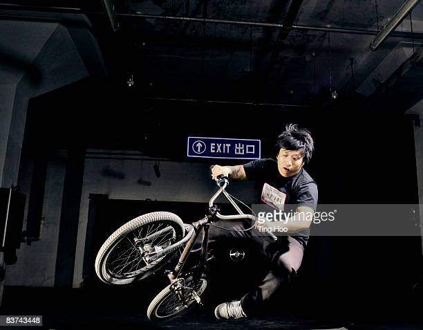 Man on BMX bike performing jump