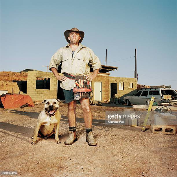 Man on building site with dog