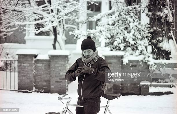 Man on bycicle in snow street