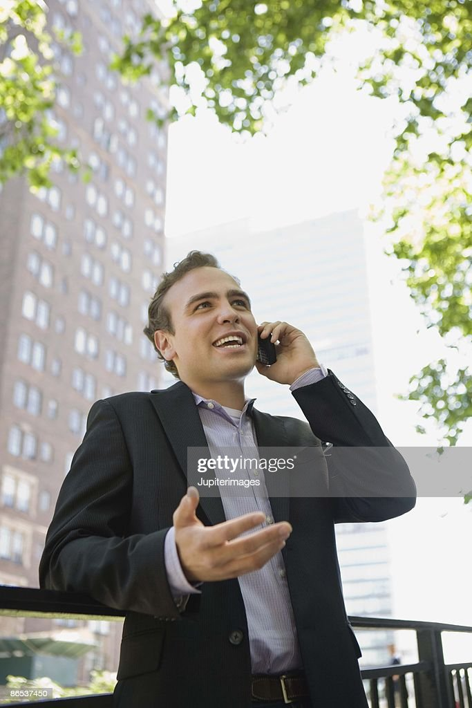 Man on cell phone outdoors : Stock Photo