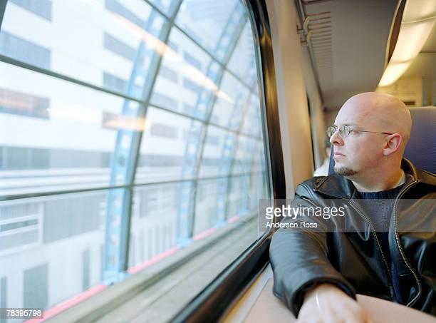 Man on commuter train