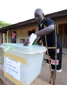 A man on crutches casts his vote at Talekura Bole Bamboi constituency in a northern region on December 7 2012 as Ghana voted in a highstakes...