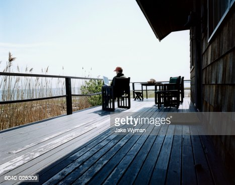 Man on Deck using Laptop : Stock Photo