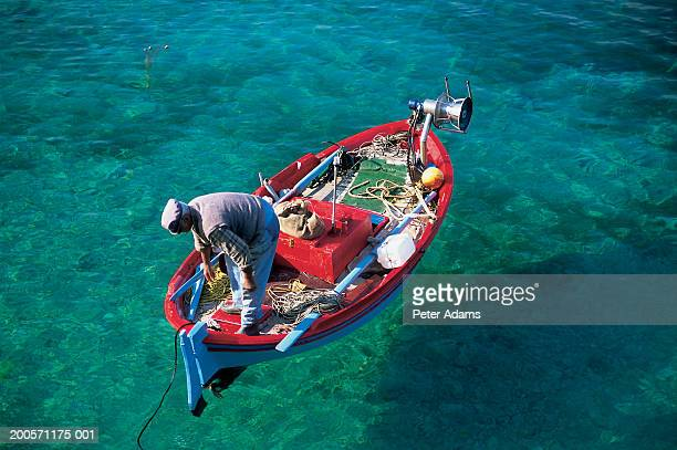 Man on fishing boat, elevated view