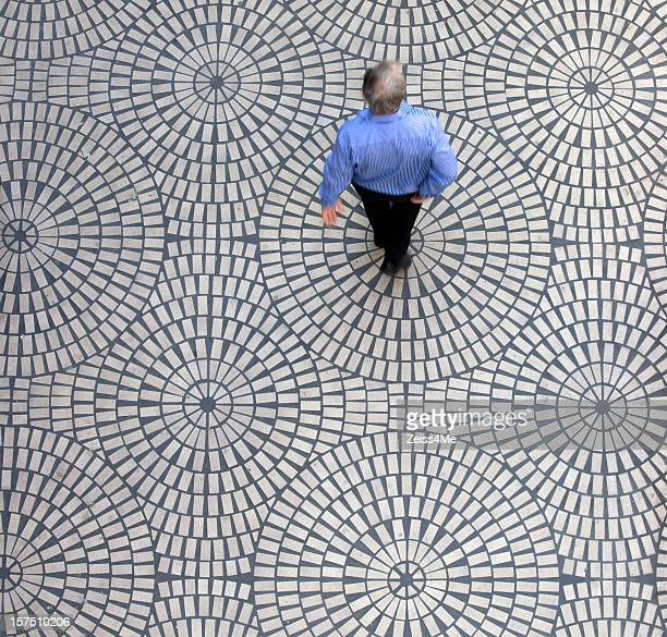 Man on geometric tiles