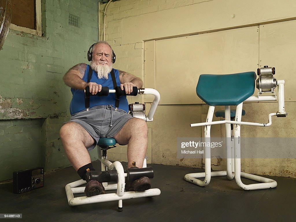 Man on gym machine : Stock Photo