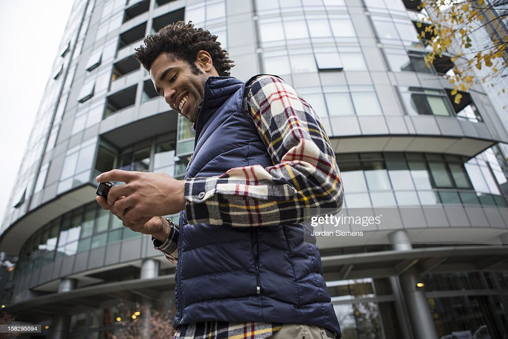 A man on his cell phone. : Stock Photo