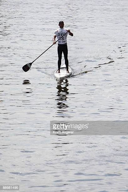 A man on his standup paddleboard is seen during day one of the Jever SUP World Cup 2009 on July 10 2009 in Hamburg Germany