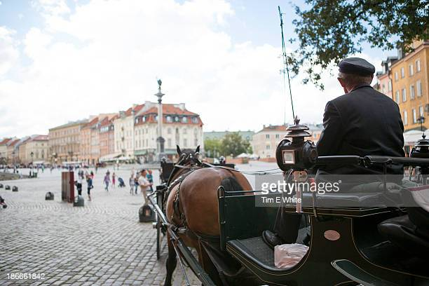 Man on horse and carriage, Warsaw, Poland
