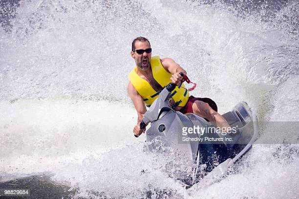 Man on jet ski on lake