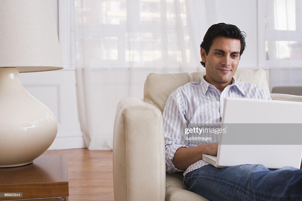 Man on laptop computer : Stock Photo