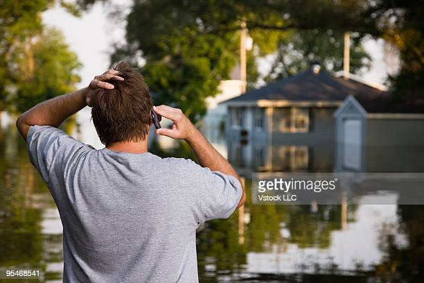 Man on mobile phone during flood