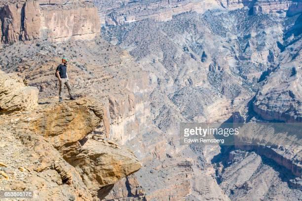 Man on mountain ledge